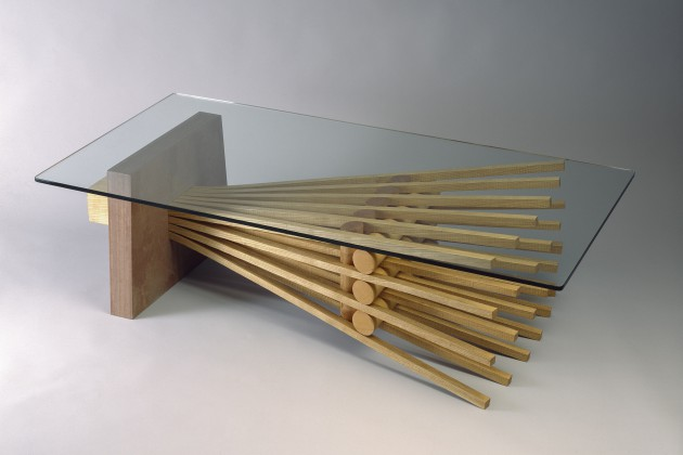Rectangular glass top coffee table with stone and bent wood, available in custom sizes from Seth Rolland furniture maker