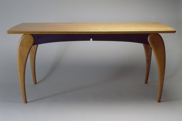 Rectangular wood dining table in cherry with curved legs custom made by Seth Rolland furniture design