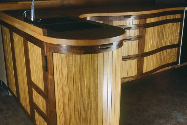 Curved kitchen cabinets in oak and walnut by Seth Rolland custom furniture design