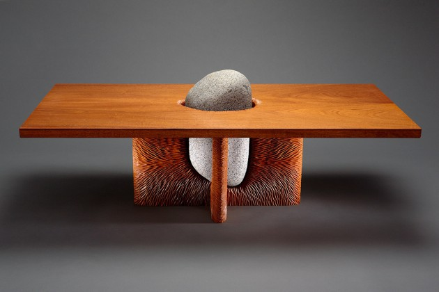 Tsubo coffee table made from mahogany wood and granite stone with hand carved base by Seth Rolland custom furniture design