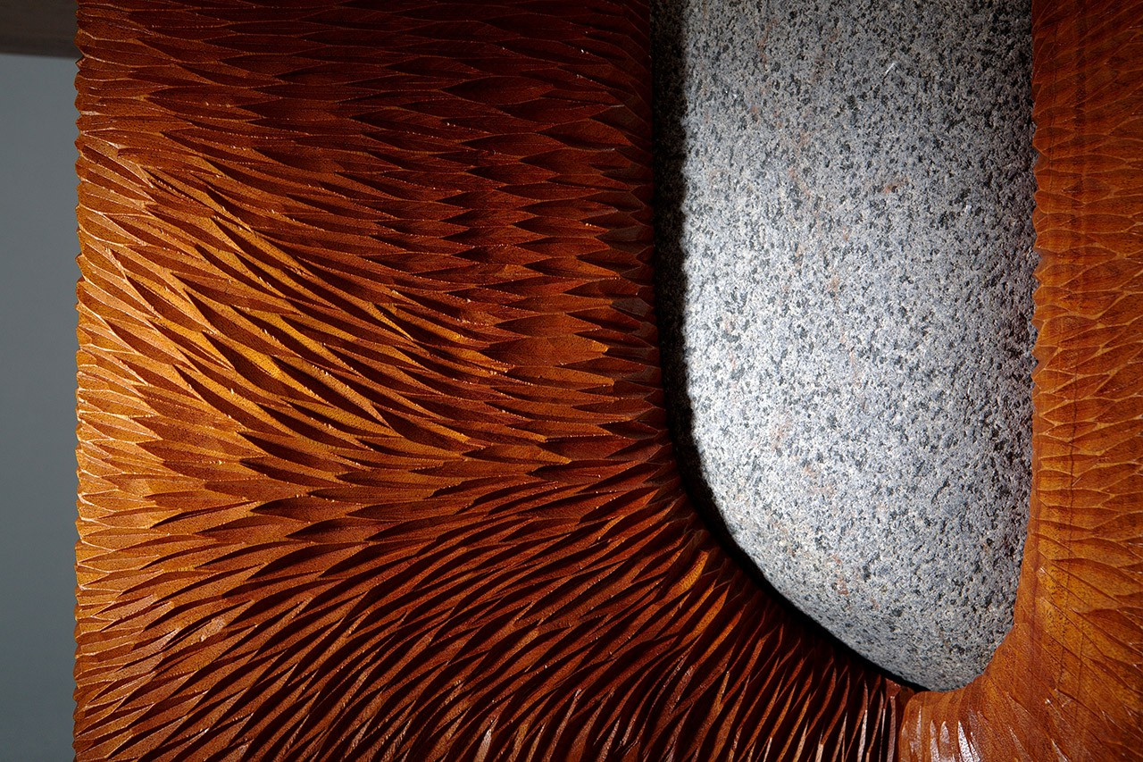 Carved mahogany and stone Tsubo coffee table detail hand carved by Seth Rolland custom furniture design