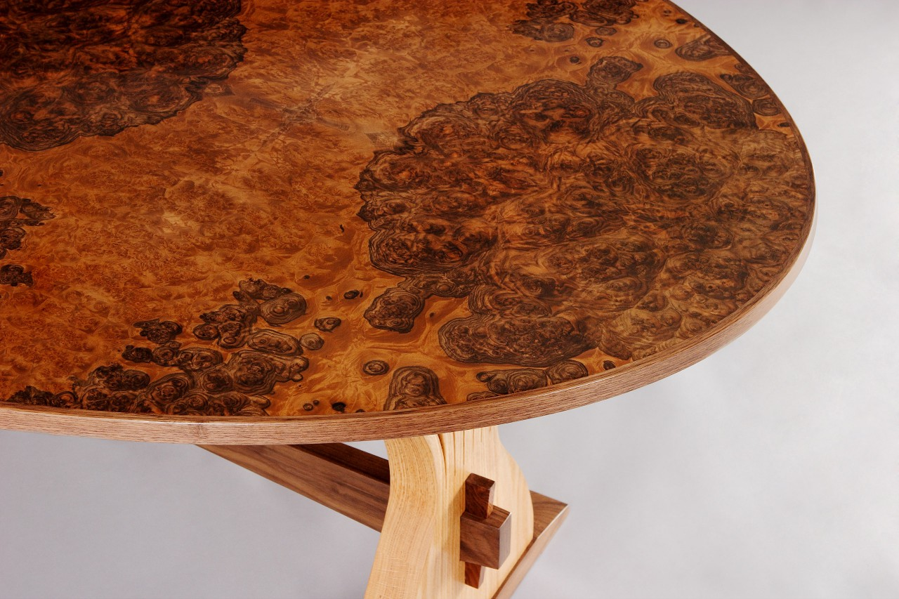 Oval expanding dining table top in walnut burl by Seth Rolland custom furniture design