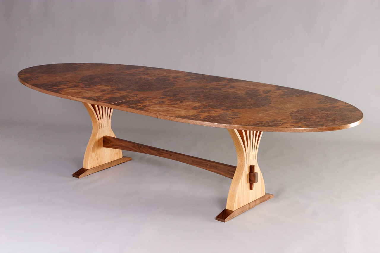 Elliptical dining table expanding with leaf custom made by Seth Rolland fine furniture design