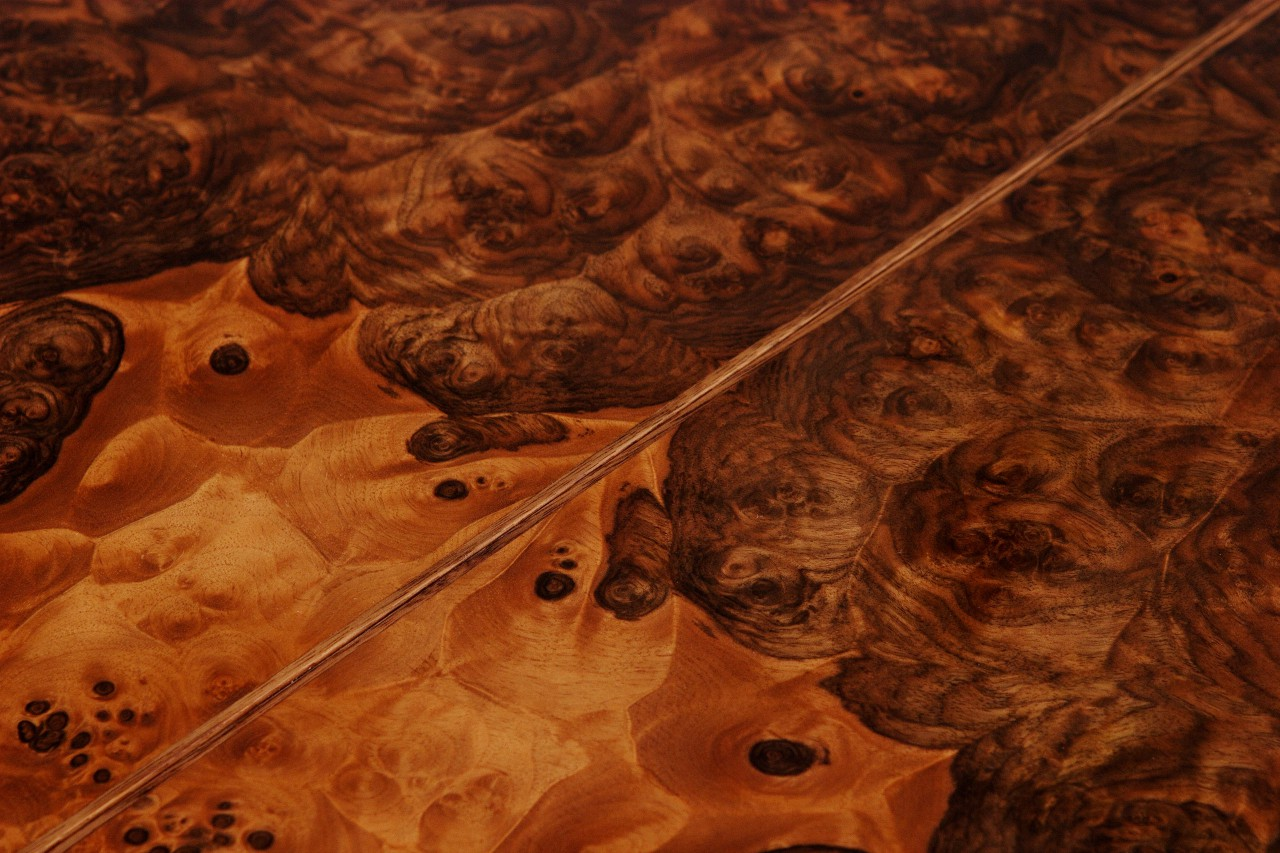 Walnut burl veneer top of Abanico dining table by Seth Rolland custom furniture design