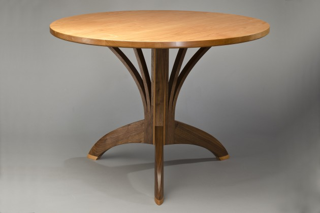 Round cafe table, round dining table with carved solid wood, walnut, cherry hand crafted by Seth Rolland furniture maker