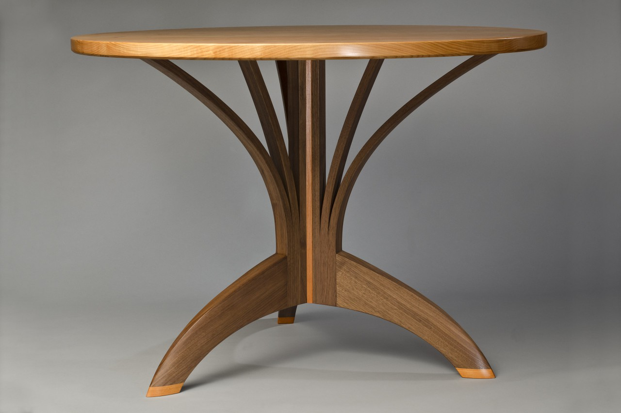 Round dining cafe table in walnut and cherry by Seth Rolland custom furniture design