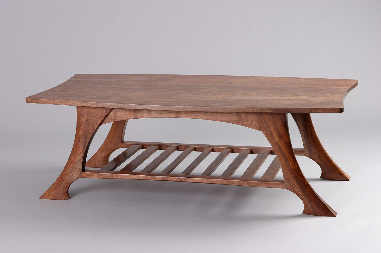 solid, carved walnut wood coffee table with shelf by Seth Rolland custom furniture design woodworker
