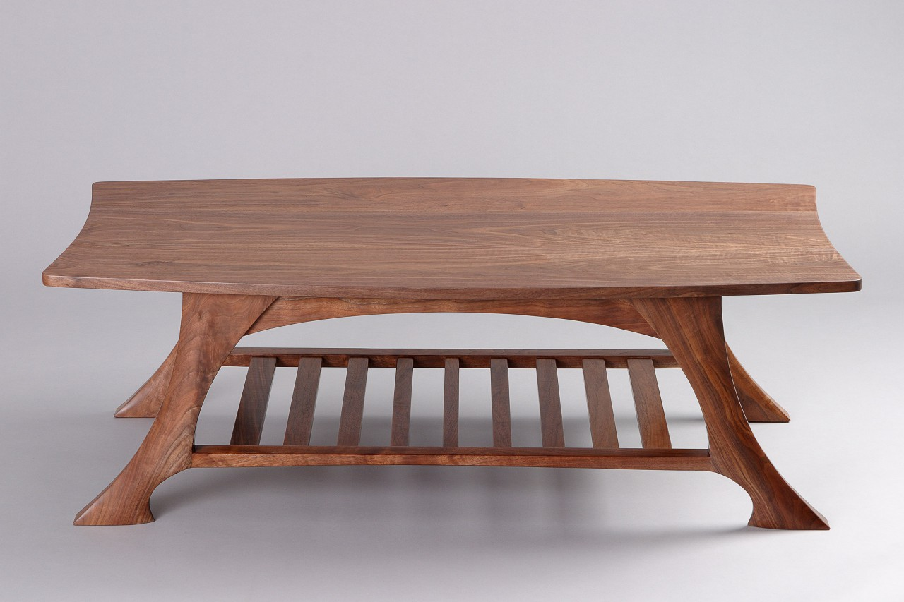Coffee table with walnut shelf and carved legs custom made by Seth Rolland fine furniture design