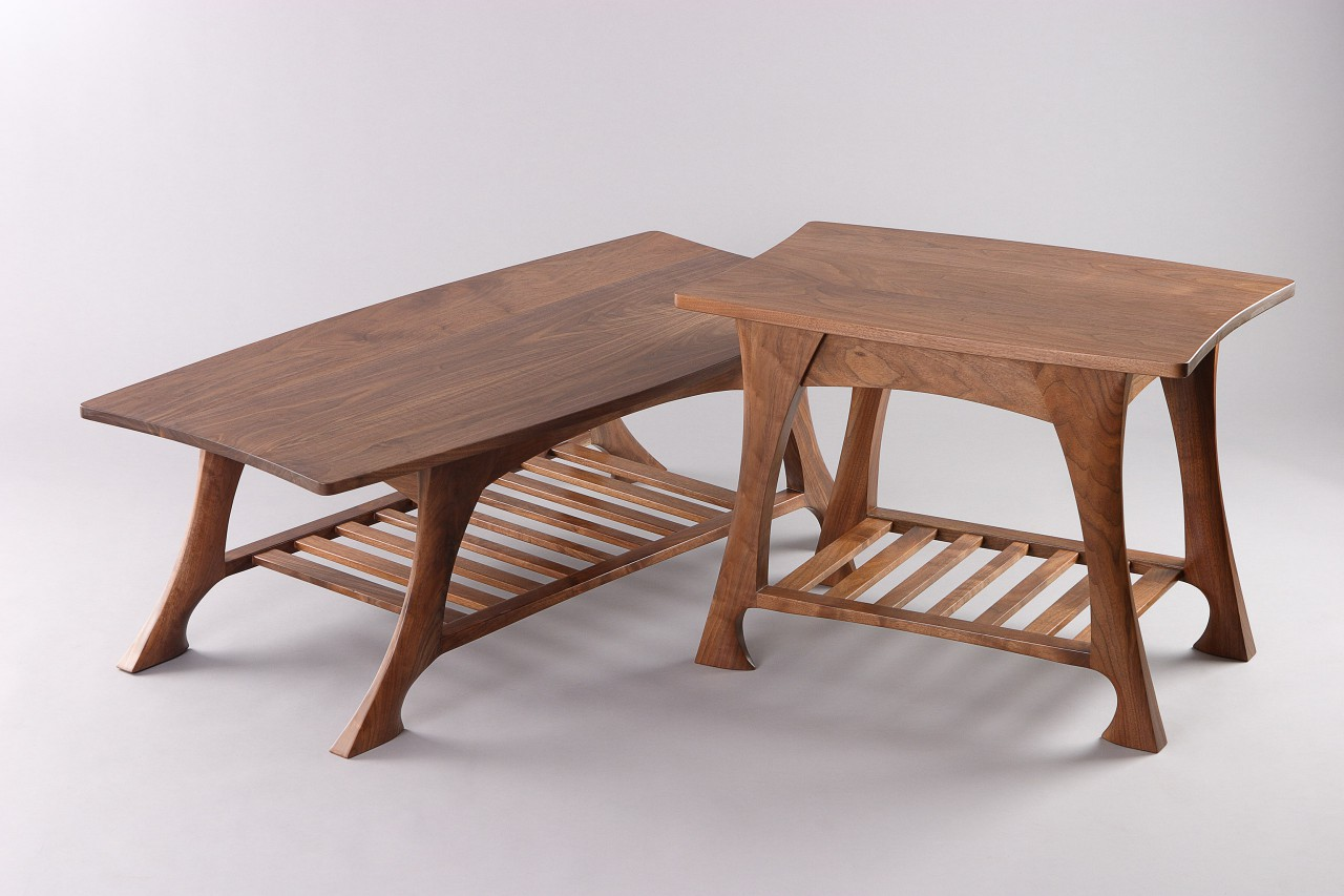 End table, coffee table and side table with shelves in hand carved walnut by Seth Rolland custom furniture design