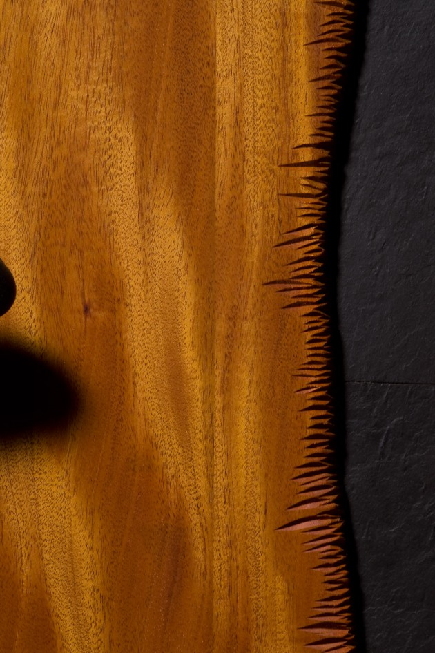 Custom carved mahogany door with slate and stone by Seth Rolland woodworks