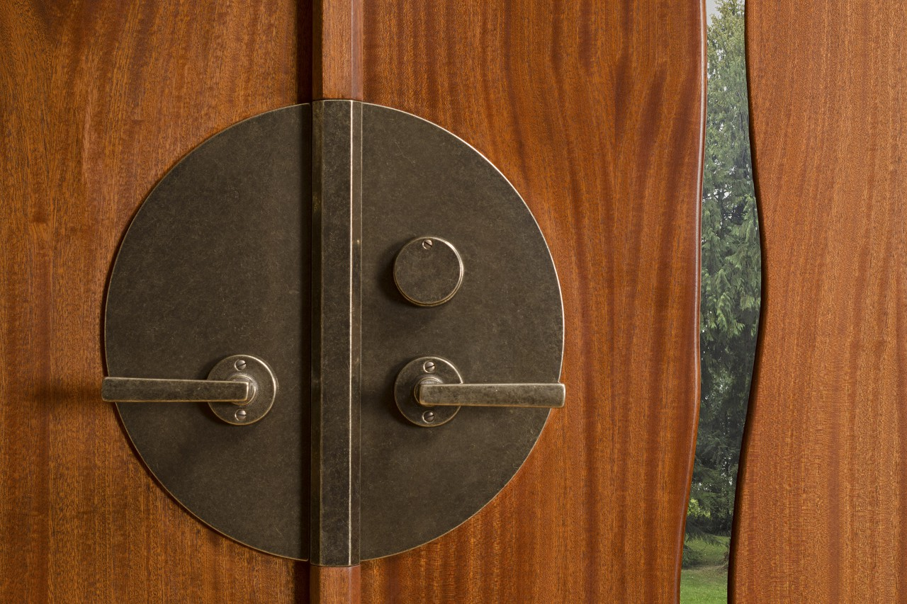 Lock and handle detail for Cascade double door by Seth Rolland custom furniture design