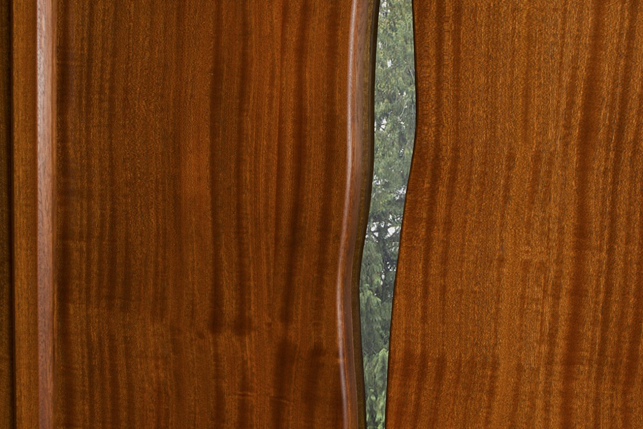 Double doors made from sapele, glass and bronze by Seth Rolland custom furniture design