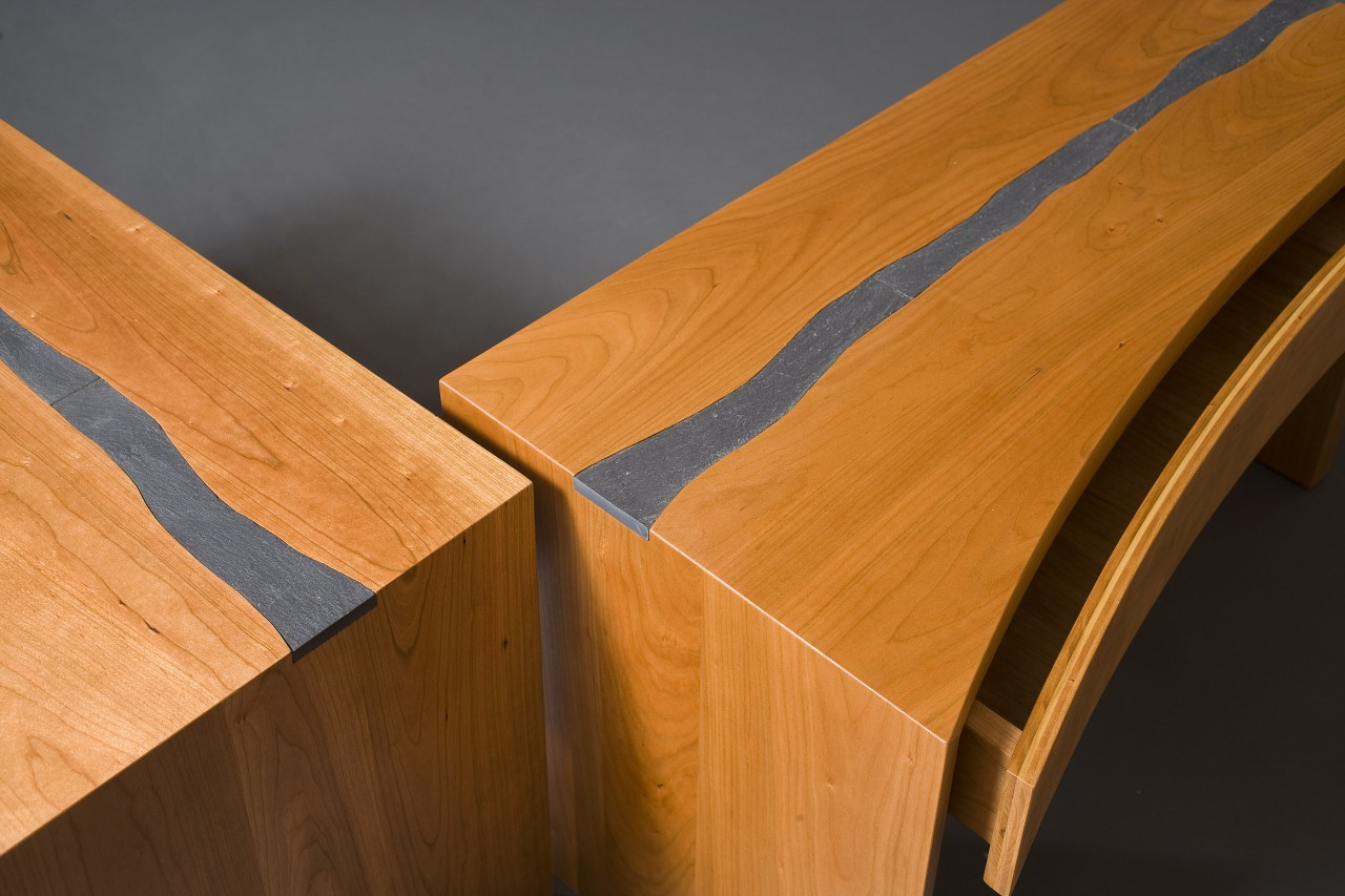 Detail of wood and slate nightstands with drawers custom made by Seth Rolland woodworks