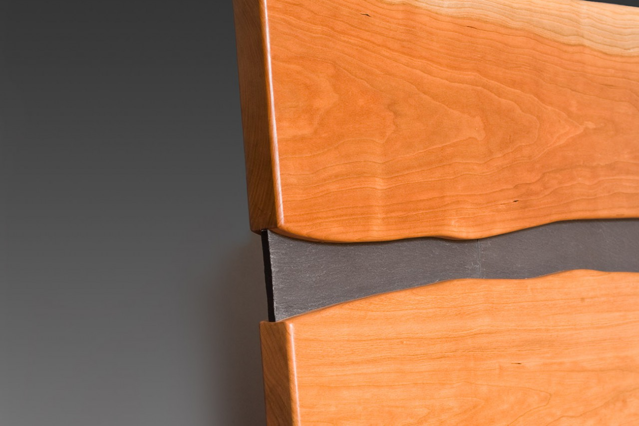 Detail of Cayuga cherry bed and nightstand with stone, custom made by Seth Rolland furniture design