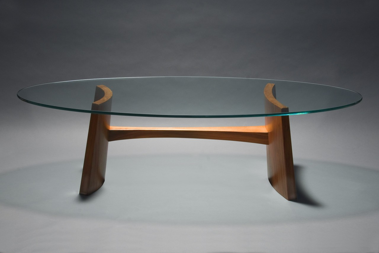 Clearwater coffee table with oval glass and solid coopered walnut wood by Seth Rolland custom furniture design