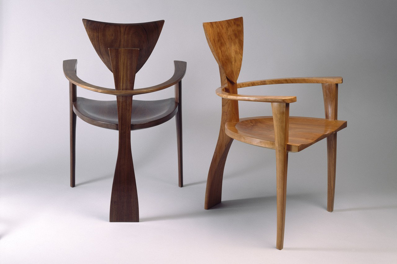 Finback chairs custom made in walnut and cherry with arms for dining or desk by Seth Rolland custom furniture design