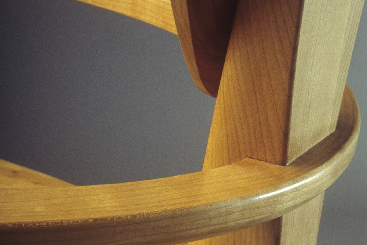 detail of Finback cherry arm chair custom designed and built by Seth Rolland fine furniture