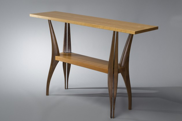 Modern, sculptural solid wood hall table made from walnut and cherry wood by Seth Rolland Custom Furniture LLC