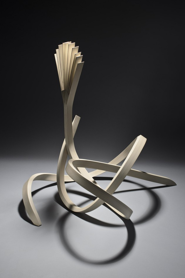 Helios wood sculpture by Seth Rolland
