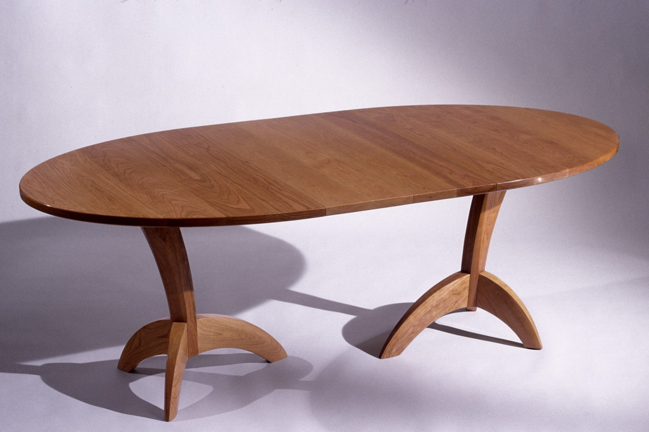 Ibis expanding dining table with leaves, solid carved cherry wood, by Seth Rolland custom furniture design