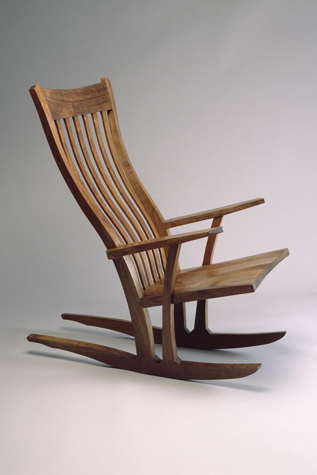 comfortable walnut wood rocking chair with flexible back slats hand carved and fitted by Seth Rolland custom furniture