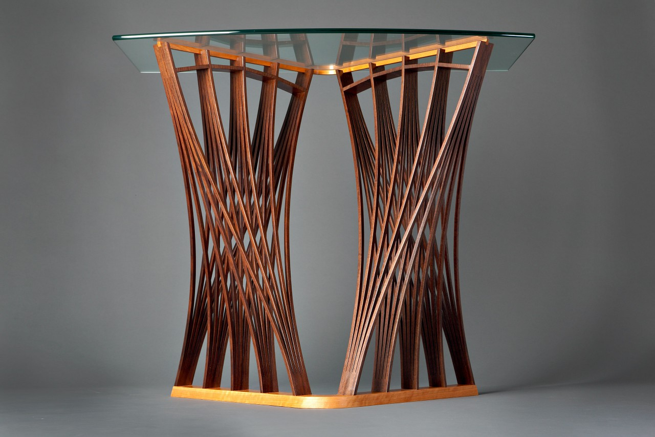 Expanded wood Parabola entry hall table console with glass top custom madeby Seth Rolland furniture design