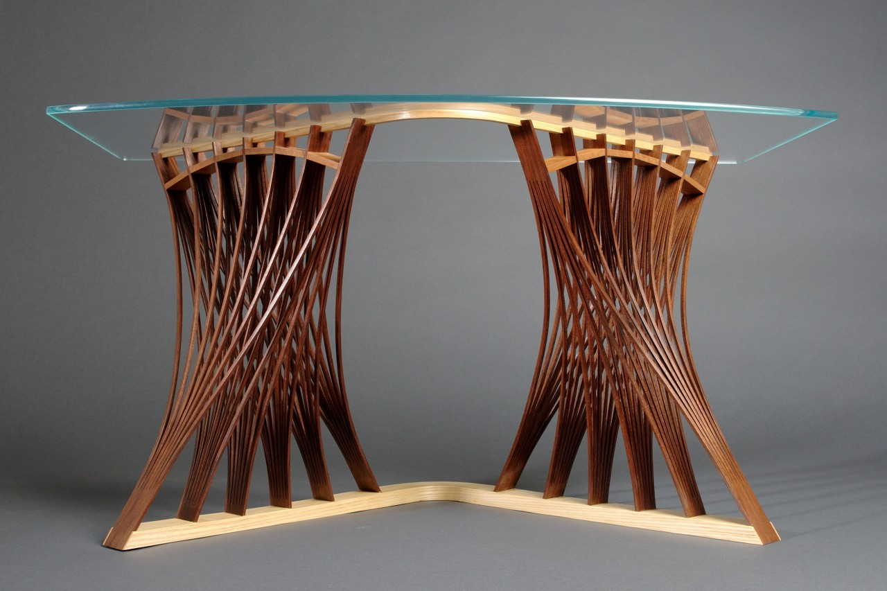 Low view of Parabola side table or end table in walnut and ash with glass top by Seth Rolland custom furniture design