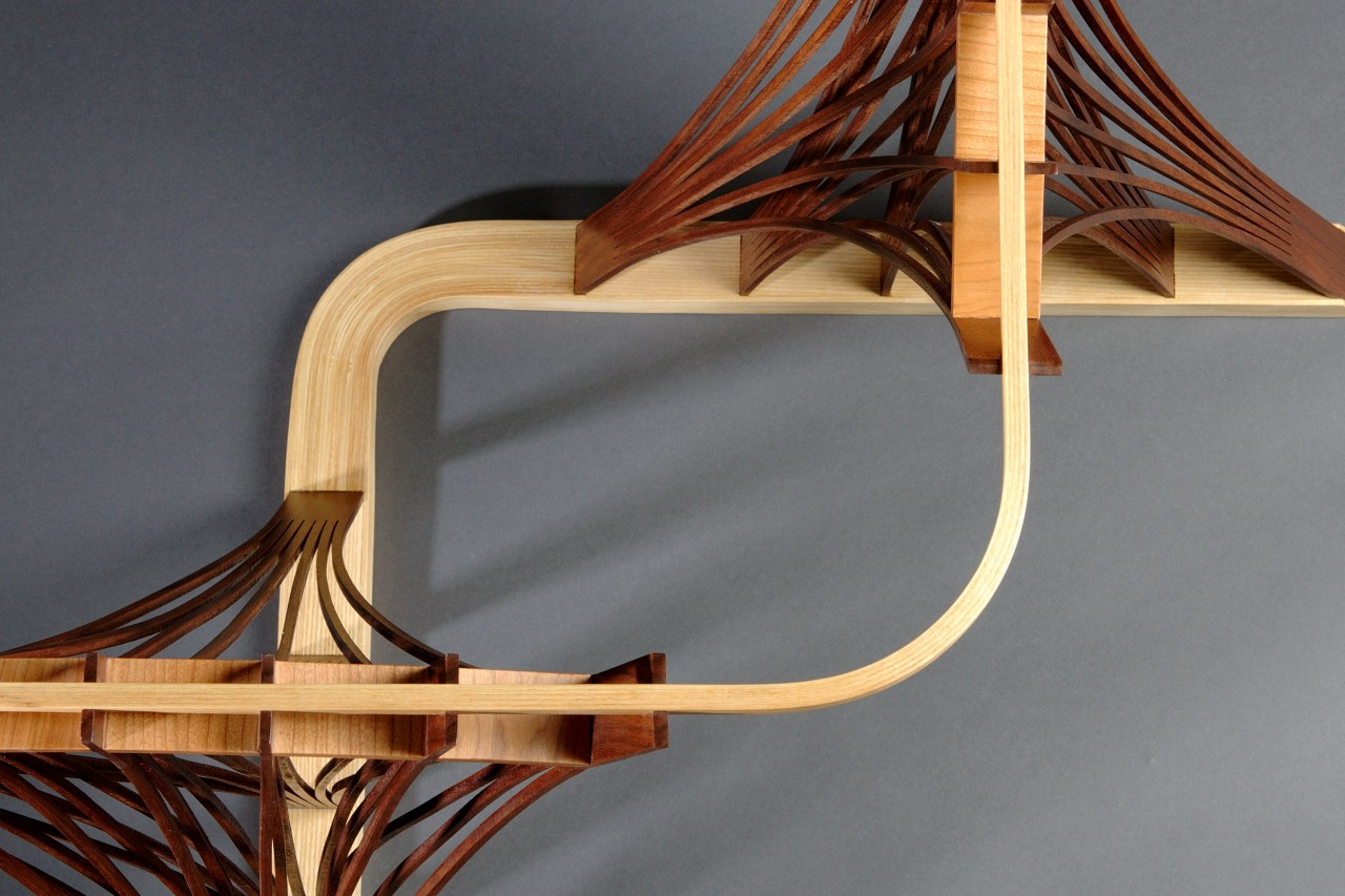 Detail of Parabola side table by Seth Rolland custom furniture, showing steam bent and laminated elements
