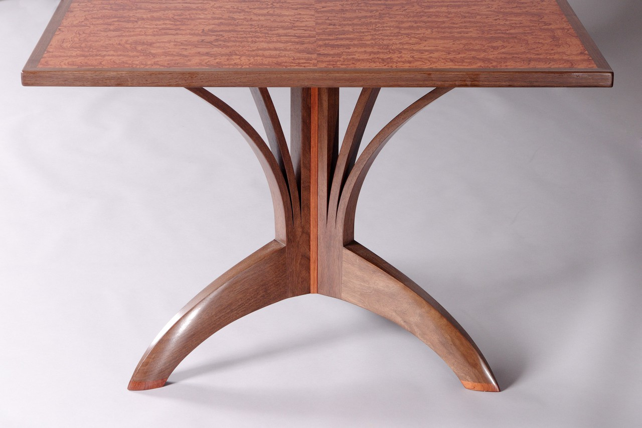 curved organic tree base dining table with walnut and bubinga by Seth Rolland custom furniture design studio