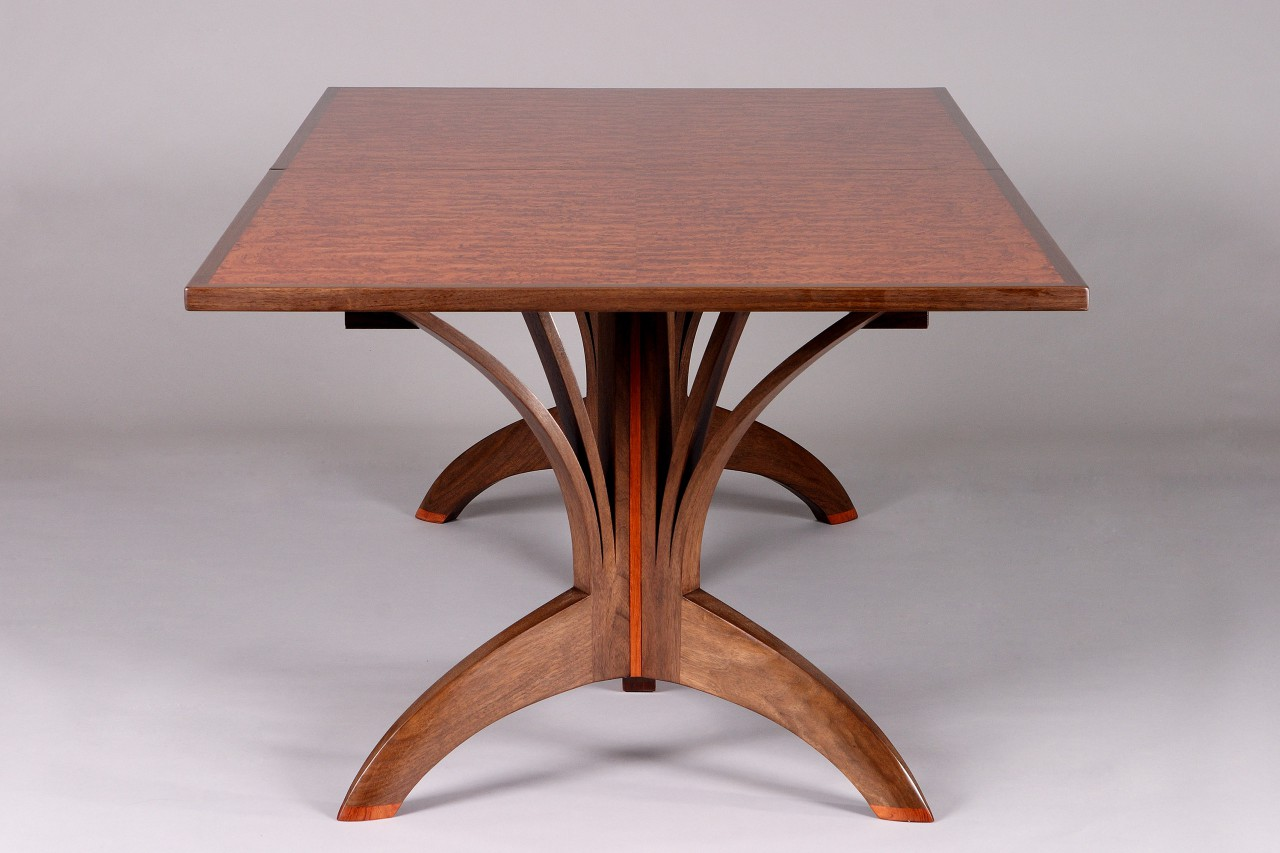 wood dining table crafted from solid walnut and bubinga veneer by Seth Rolland custom furniture design