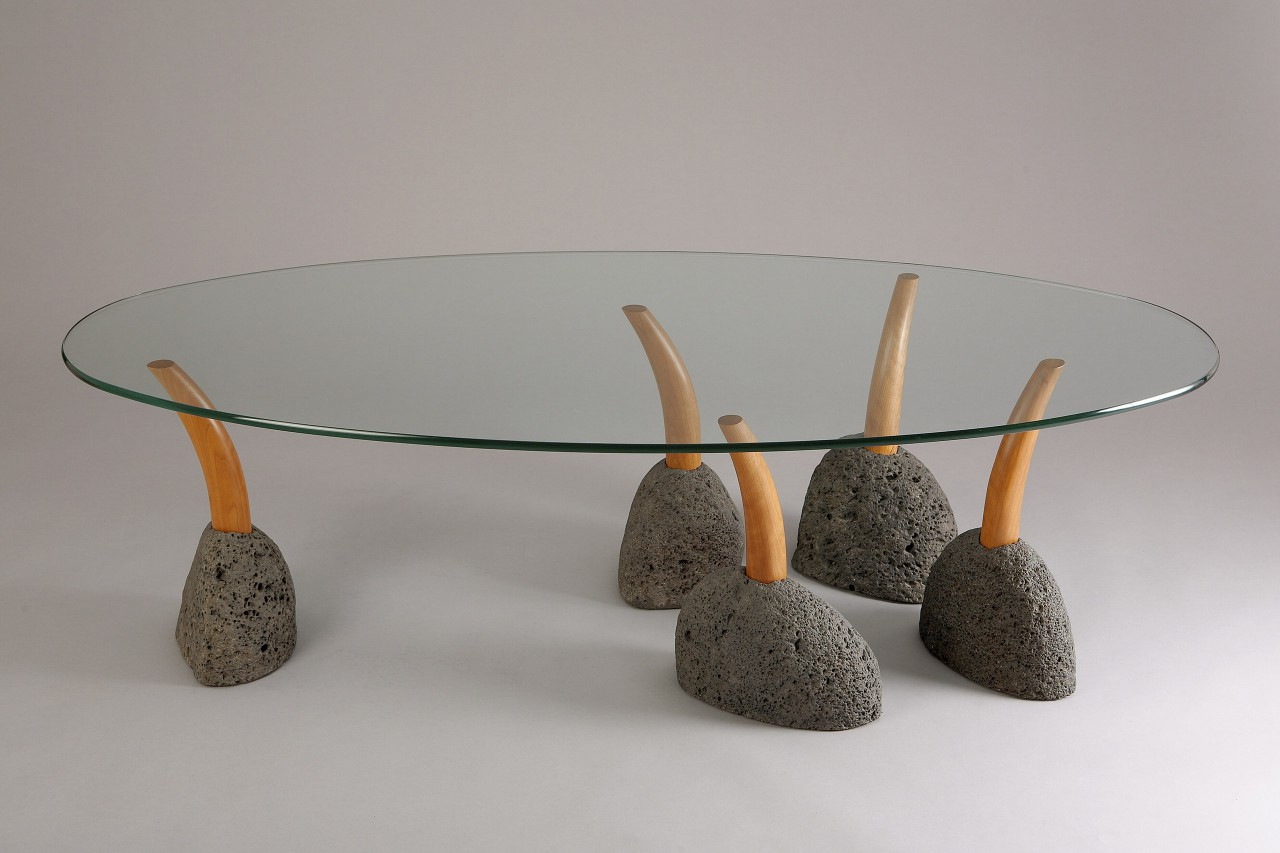 Rearranging the legs of oval Sprout coffee table, zen garden style, handcrafted by seth Rolland custom furniture
