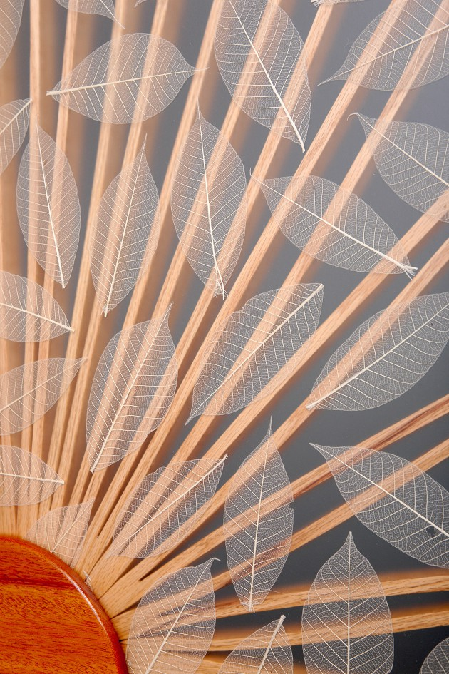 Detail of Sun and Leaf Room divider custom made by Seth Rolland fine furniture