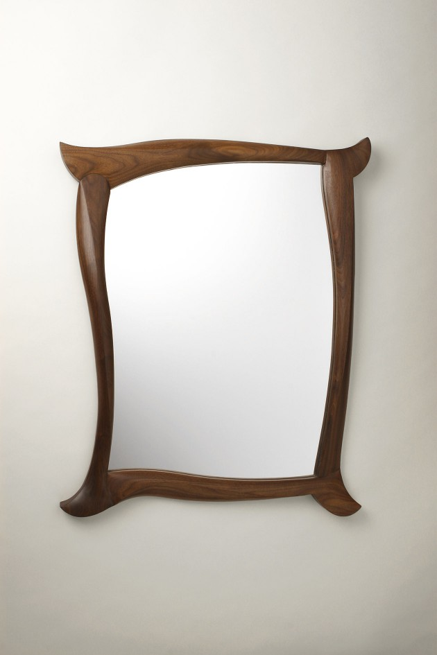 Walnut wall mirror with carved sculptural frame by Seth Rolland custom furniture design