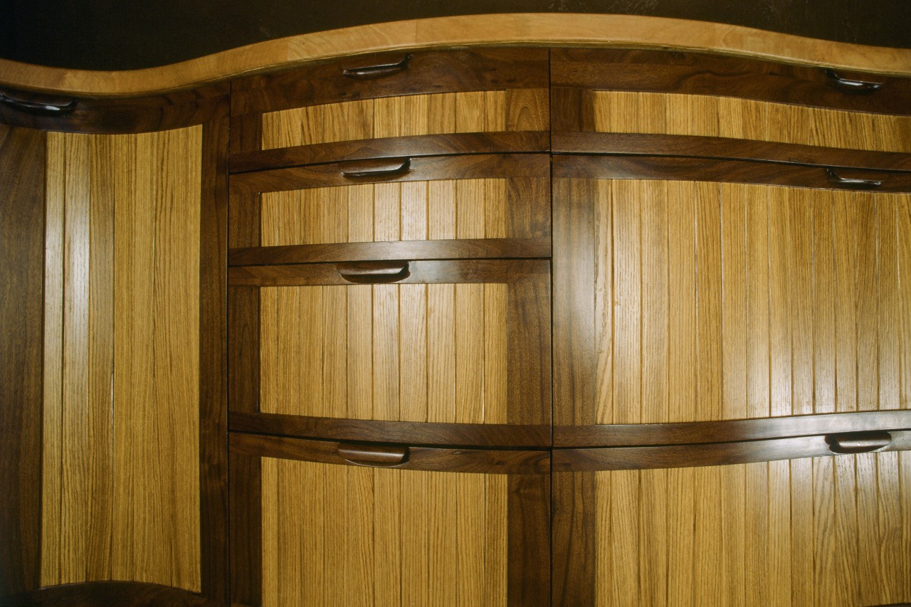 Curved walnut and oak cabinets by Seth Rolland custom furniture design