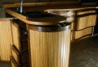 Curved kitchen with doors and drawers open by Seth Rolland custom furniture design