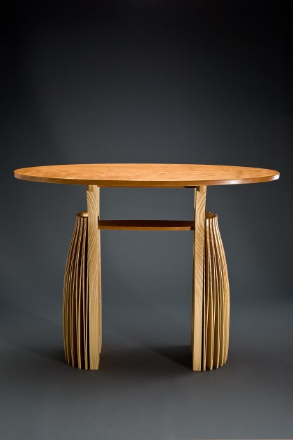 Expanded wood entry hall table console from ash and cherry with elliptical top by Seth Rolland custom furniture design
