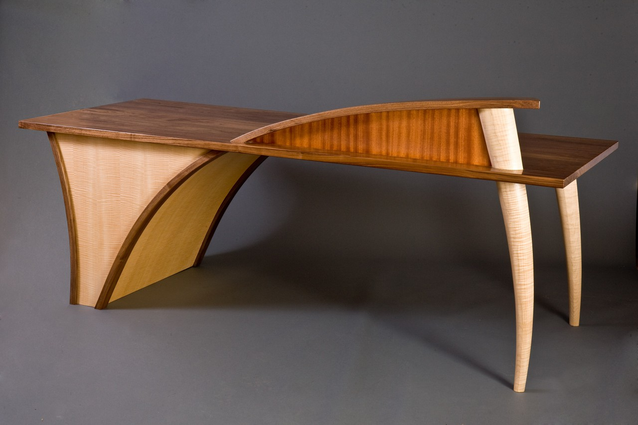 Trimerous desk custom made from walnut, sapele and curly maple by Seth Rolland furniture