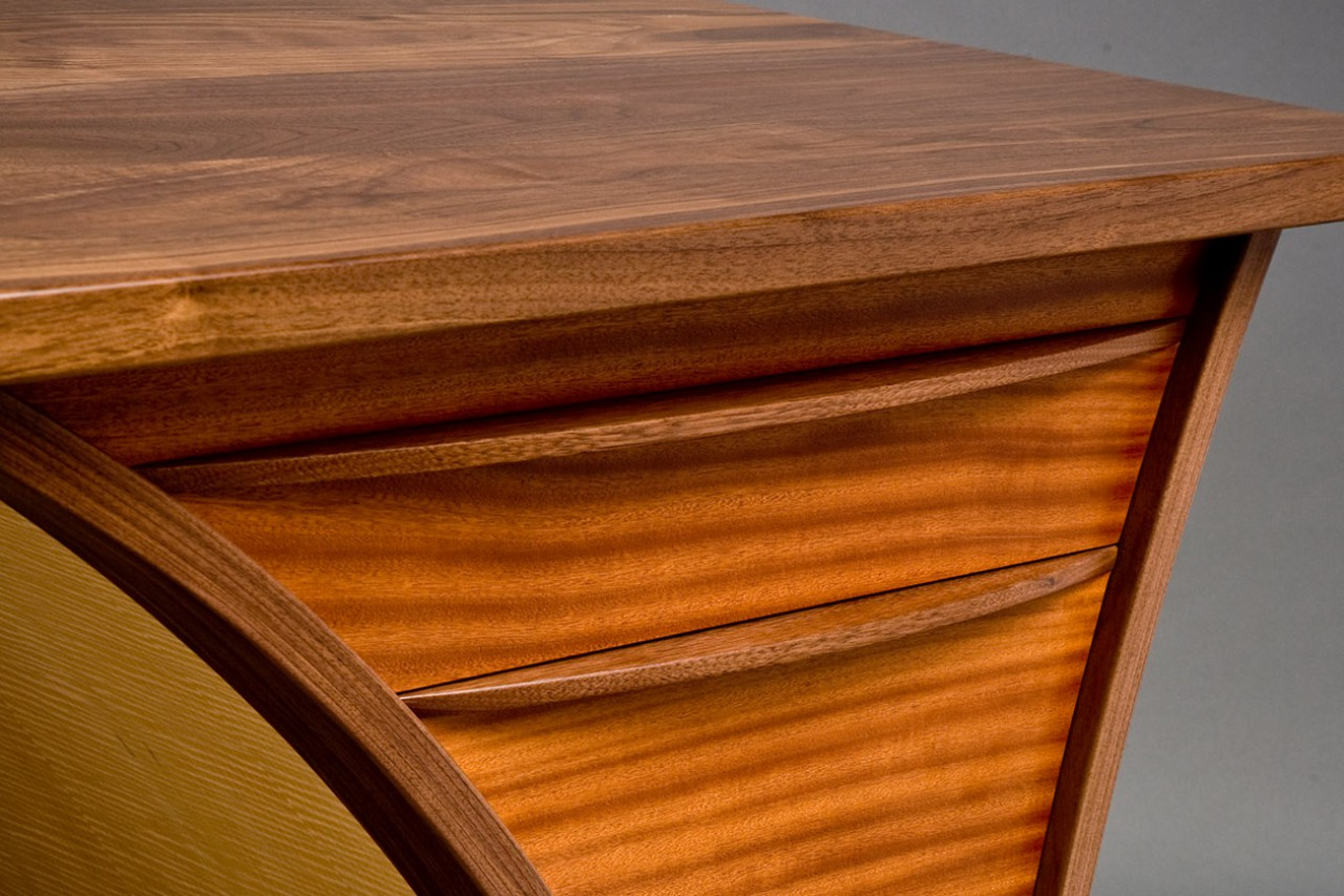 Detail of walnut, sapele and maple desk by Seth Rolland custom furniture design