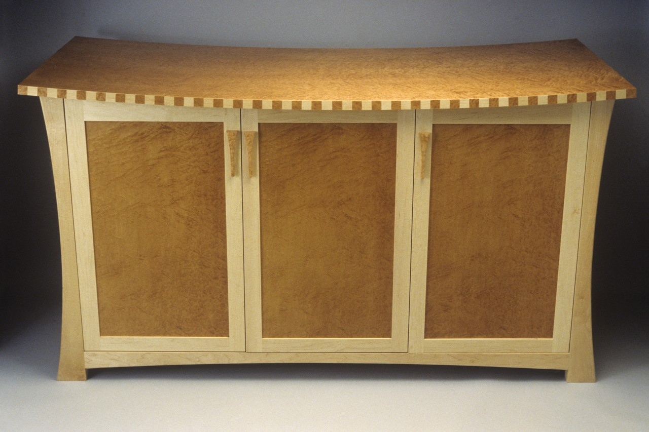 Liquor cabinet, buffet or entertainment center in birdseye maple by Seth Rolland custom furniture studio
