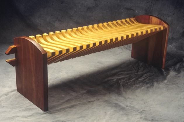 Pine and cherry wood bench with curved seat by Seth Rolland custom furniture design