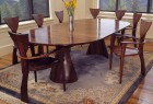 Expanding wood oval Tinsman dining table with organic base and sculptural Finback chairs hand made by Seth Rolland custom furniture design