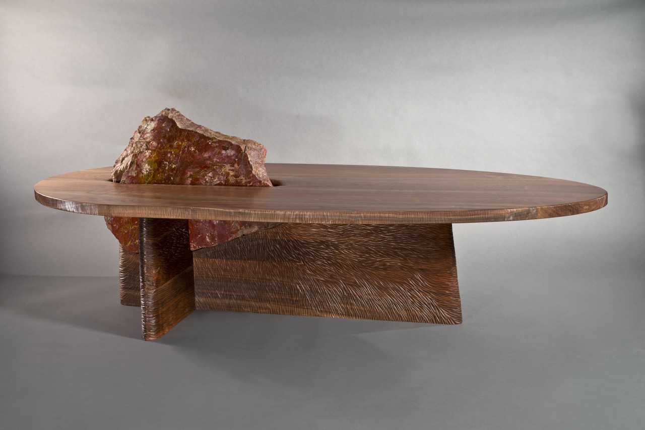 Carved wood and polished stone combine for an organic contemporary coffee table