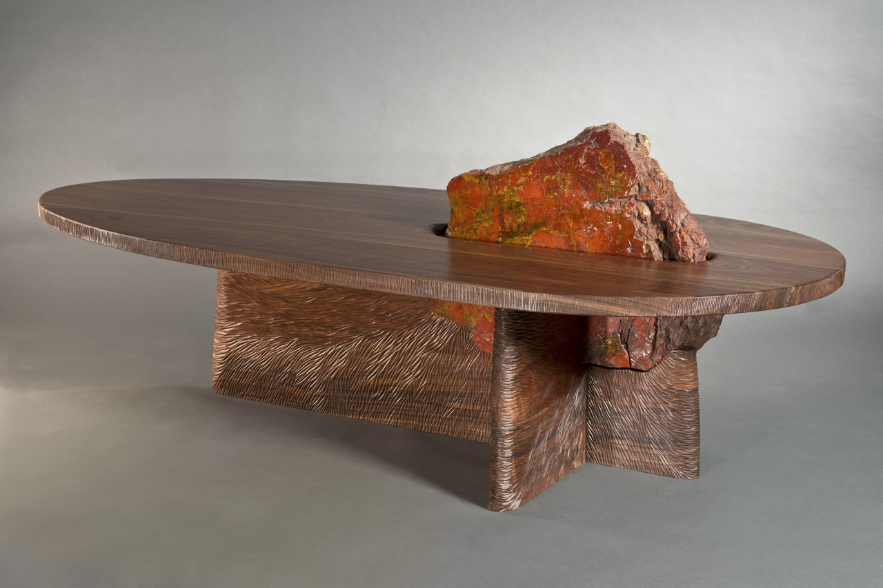 One of a kind wood and stone coffee table with hand carved base.