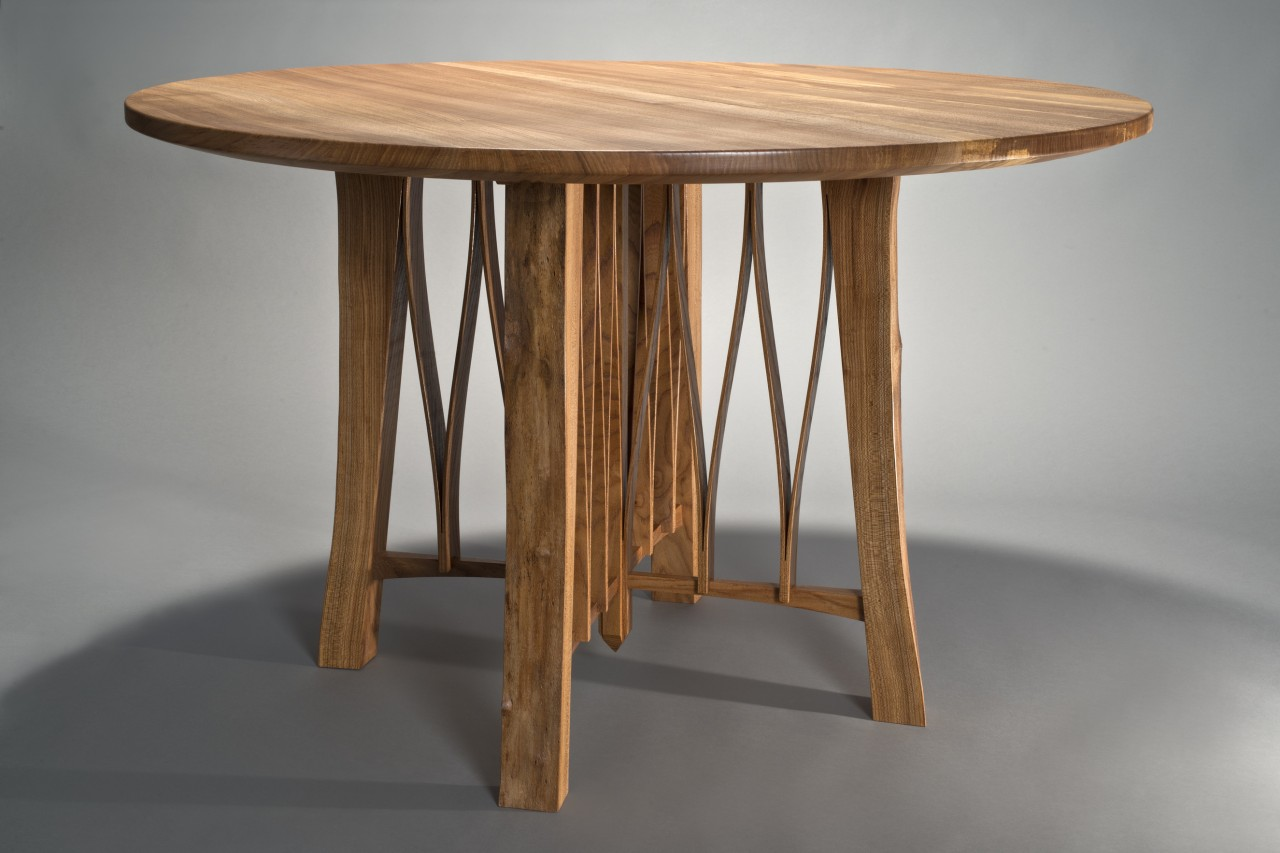 Contemporary solid wood round dining table by Seth Rolland fine furniture