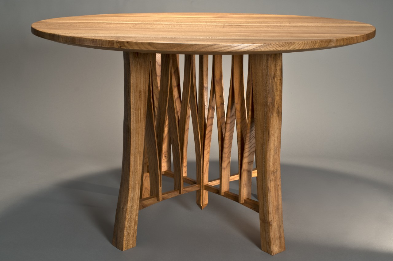 Live edged round cafe table for 4 made from solid wood with a natural edge by Seth Rolland furniture
