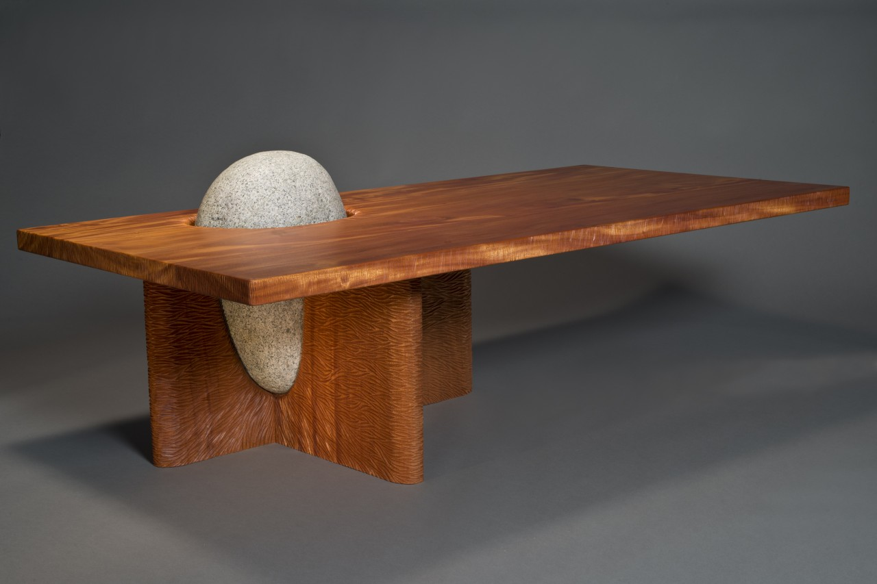 handmade custom cantilevered Eddy coffee table with carved mahogany and granite hand crafted by Seth Rolland furniture