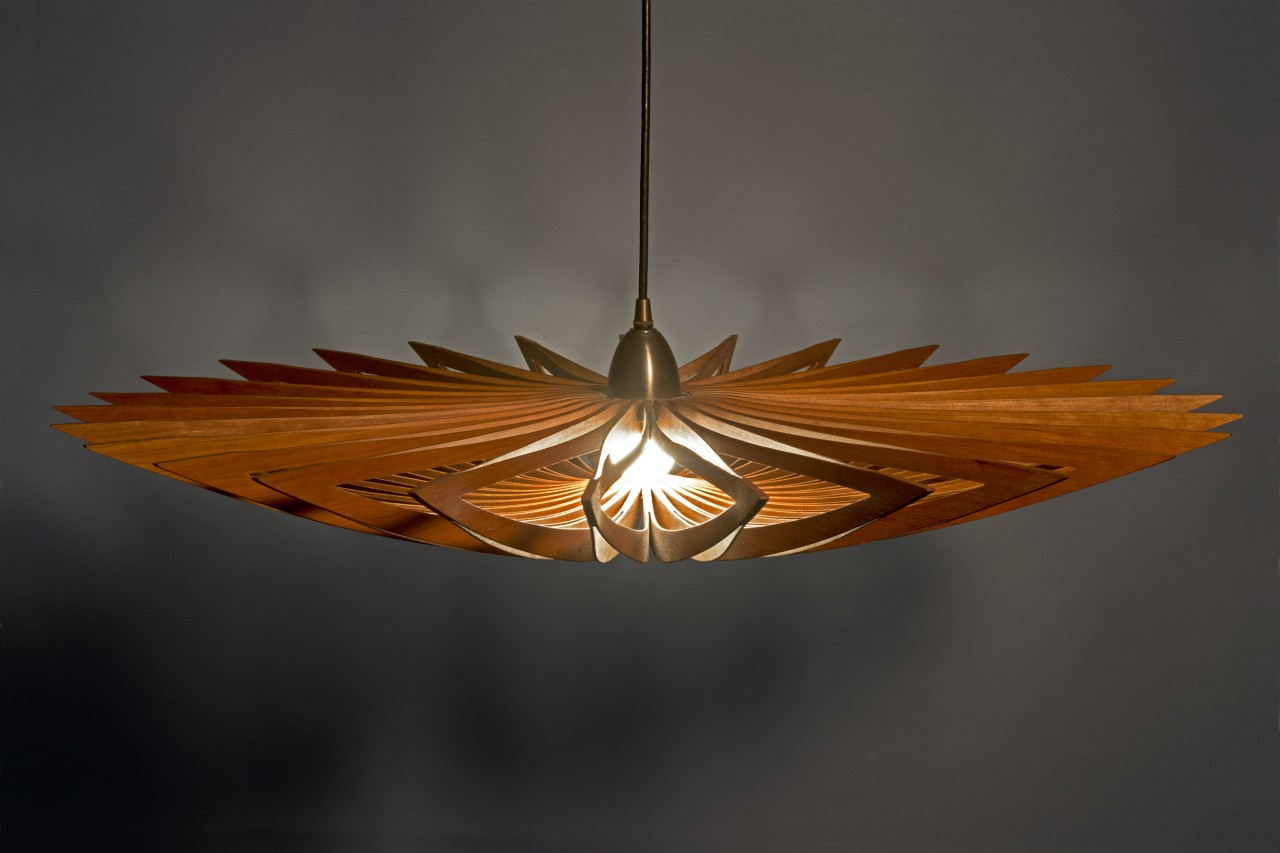 Starfish Hanging Lamp with dimmable LED bulb made from one piece of cherry wood by Steh Rolland Custom Furniture Design