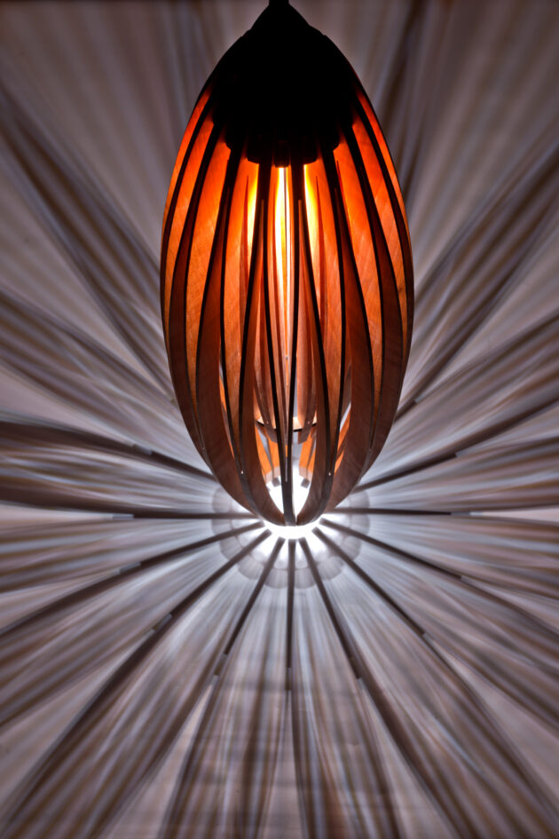 Tulip cherry wood hanging pendant lamp with shadows by Seth Rolland